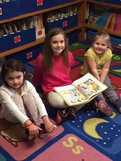 2nd grade students reading to preschoolers